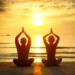 http://www.dreamstime.com/royalty-free-stock-image-young-couple-practicing-yoga-beach-image28304196